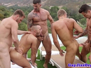Athletic gay hunks fuck ass in the sun