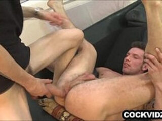 Big uncut cock working its way inside an ass