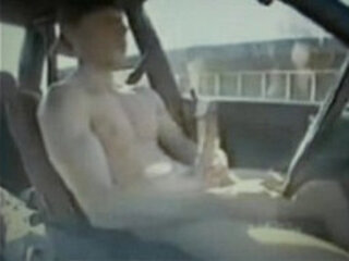 hot dude driving car jerking his huge cock and cums