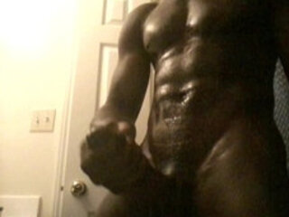 oiled chocolate man beats his long hard black dick for SEXY !